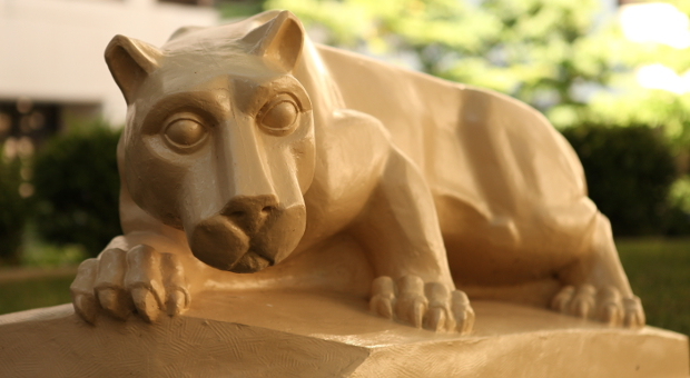Penn State College of Medicine's Nittany Lion mascot is seen in a statue in the College's courtyard in 2014.