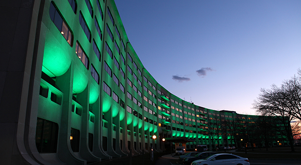 The entrance to the hospital with the LED lights shining green.