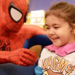 Superheroes deliver capes to young patients at Children™s Hospital