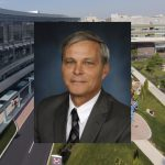 A portrait of David Smith is superimposed over a view of the Penn State Health Milton S. Hershey Medical Center and the Penn State Health Children's Hospital entrances.
