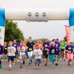 Participants run from the starting line of the Conquer Run 5K at Hersheypark.