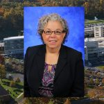Barbara Ostrov, MD, was named associate dean for faculty and professional development at Penn State College of Medicine in September 2016. Ostrov is pictured wearing a purple patterned blouse, dark blazer and glasses, in front of a blue photo background. Her photo is superimposed on the left side of an aerial image of Penn State College of Medicine's Hershey campus, with the College Crescent visible at right.