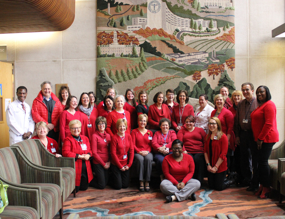 Faculty and staff from Penn State Heart and Vascular Institute pose for a photo. All are wearing red.