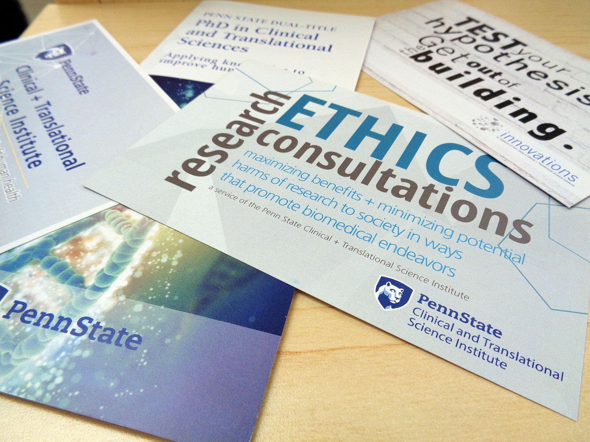 A promotional image for Penn State Clinical and Translational Science Institute shows a number of pamplets and cards advertising CTSI services fanned out on a table. The words