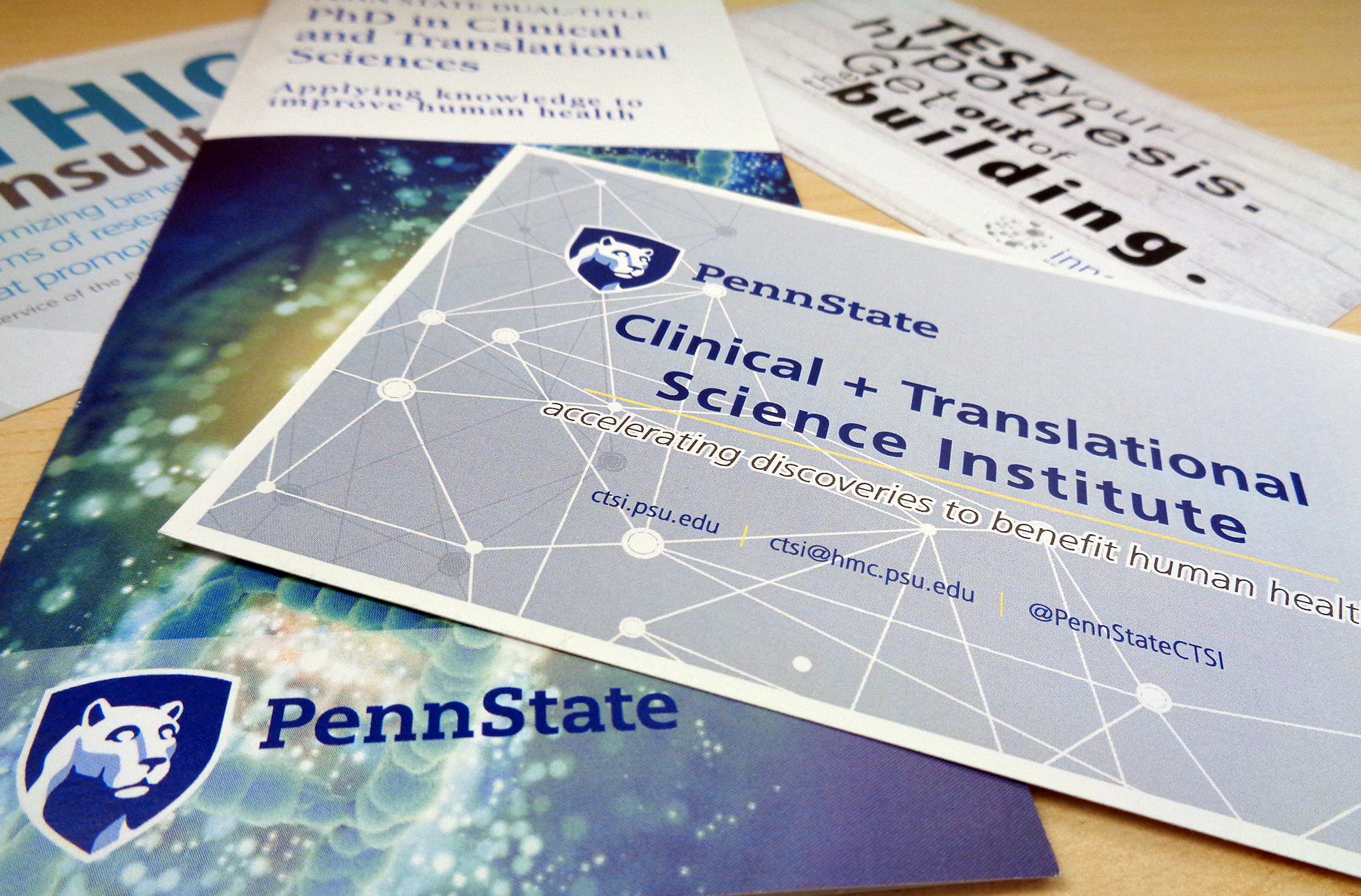 A promotional image for Penn State Clinical and Translational Science Institute shows a number of pamplets and cards advertising CTSI services fanned out on a table.