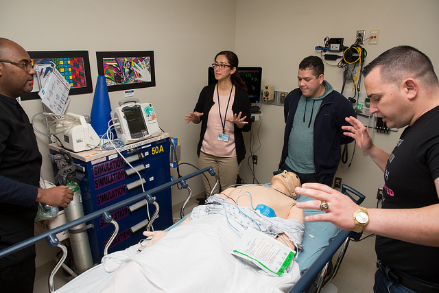 Participants of the International Medical Graduate Program work together on a cardiology lab exercise.