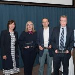 The 2018 Outstanding Collaborative Research Award was presented to a team from Penn State Tobacco Center of Regulatory Science. A group of six people are pictured holding awards, with Dr. Leslie Parent, Vice Dean for Research and Graduate Studies at Penn State College of Medicine, standing at left.