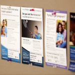Posters depicting Penn State College of Medicine clinical trials that are seeking volunteers are displayed on a bulletin board.
