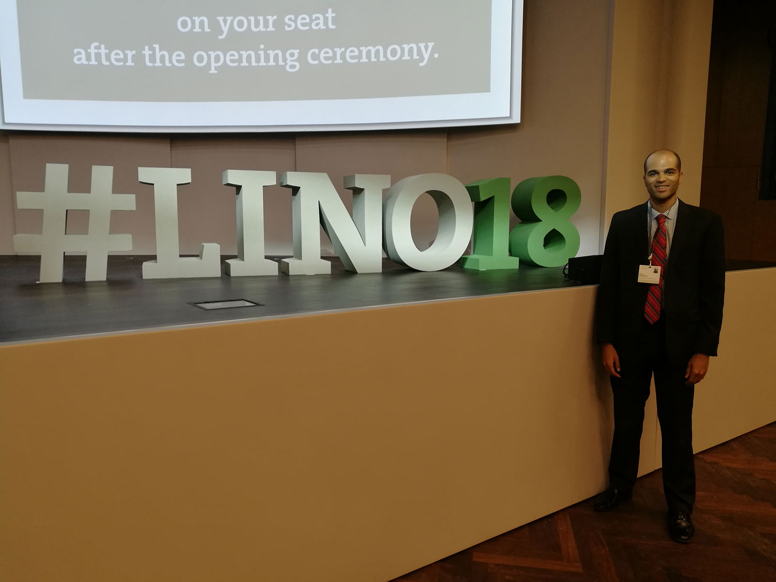 Penn State College of Medicine Biomedical Sciences PhD student Robert Nwokonko traveled to Lindau, Germany, for the 68th Lindau Nobel Laureate Meeting, held June 24 to 29, 2018. Nwokonko is pictured standing in a large space with three-dimensional letters spelling out #LINO18 standing next to him on a wall or ledge.