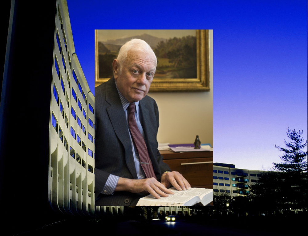 An image of Dr. Elliot Vesell reading a book is superimposed over an image of the Medical Center/College of Medicine building's signature Crescent.
