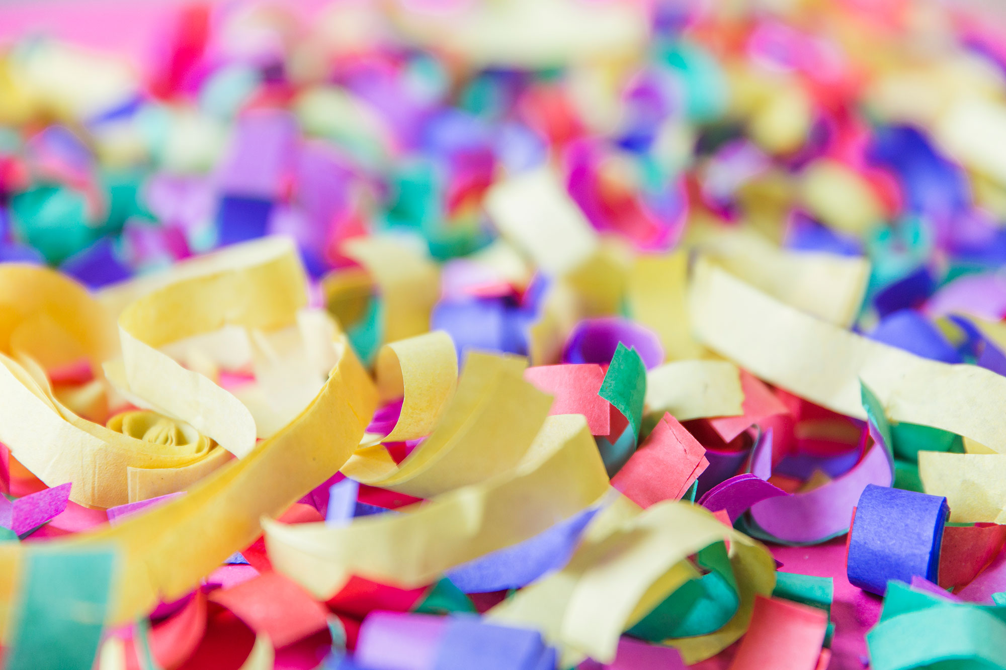An A close-up photo shows colorful paper confetti.
