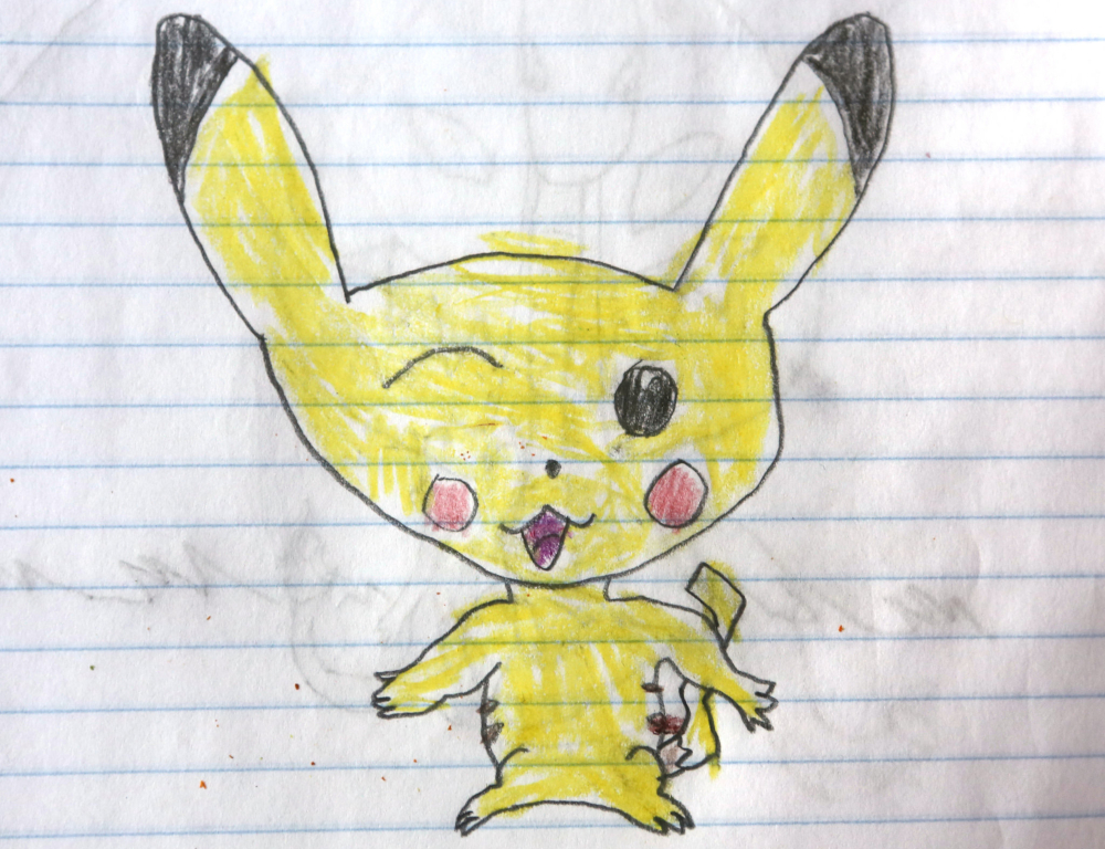 A child's drawing depicts a yellow, long-eared creature, in crayon on white lined notebook paper.