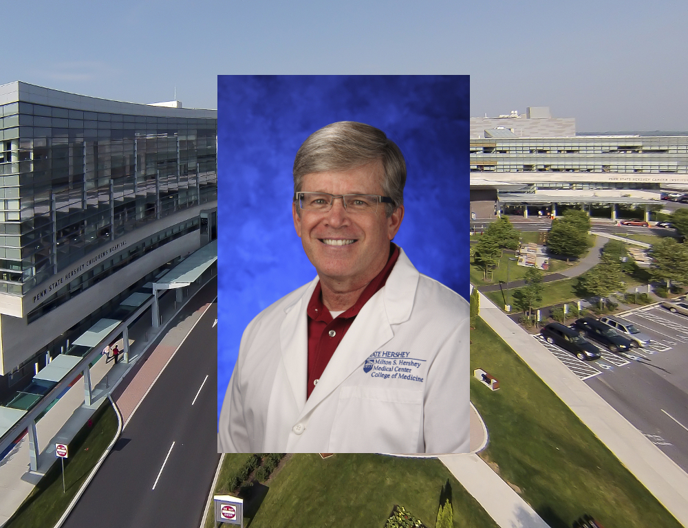 A head and shoulders photo of Dr. Kent Hymel in a physician's coat, superimposed over a photo of Hershey Medical Center.