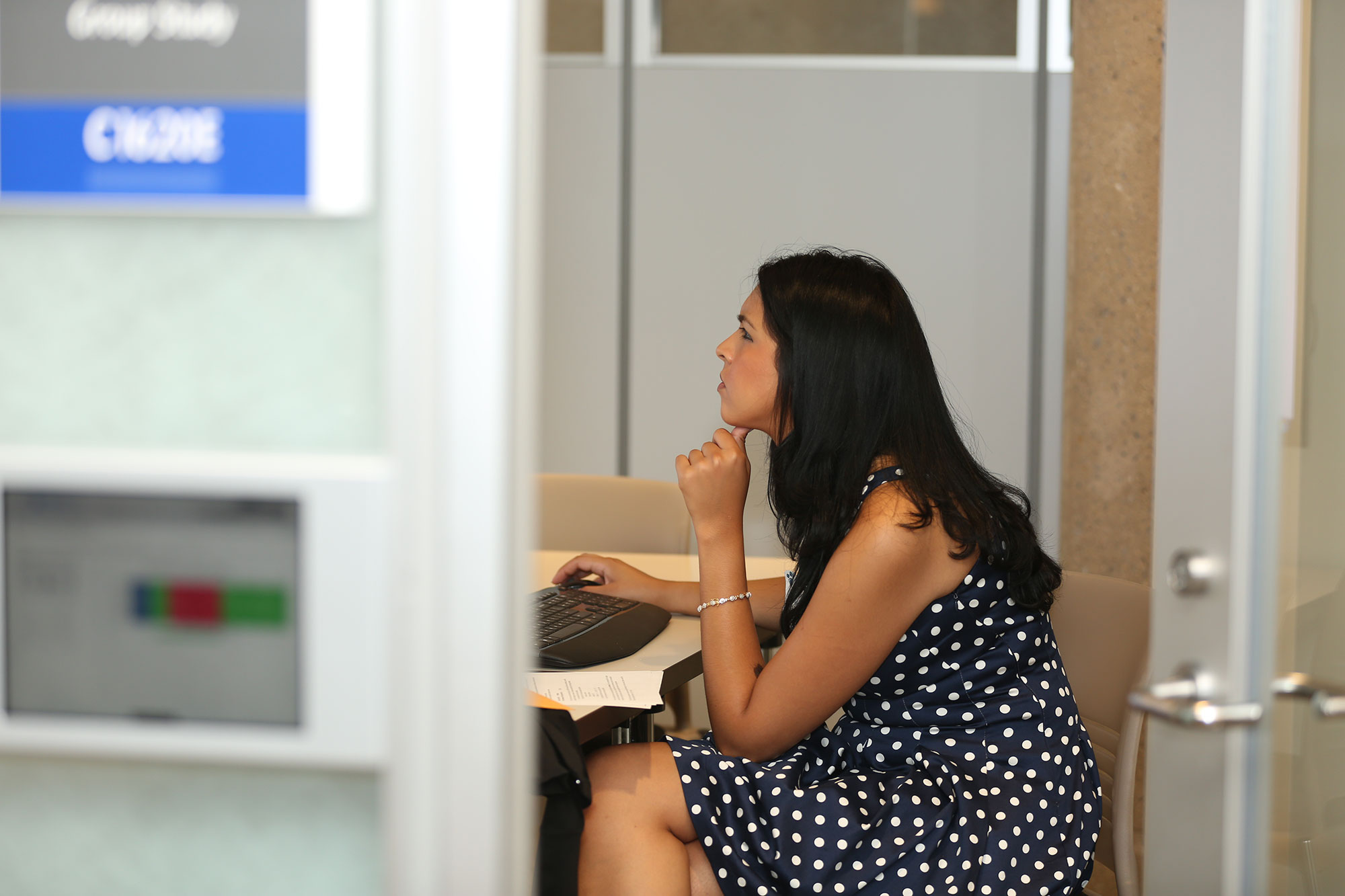 A student is seen working in a group study space at Harrell Health Sciences Library, Penn State College of Medicine, Hershey, Pa.