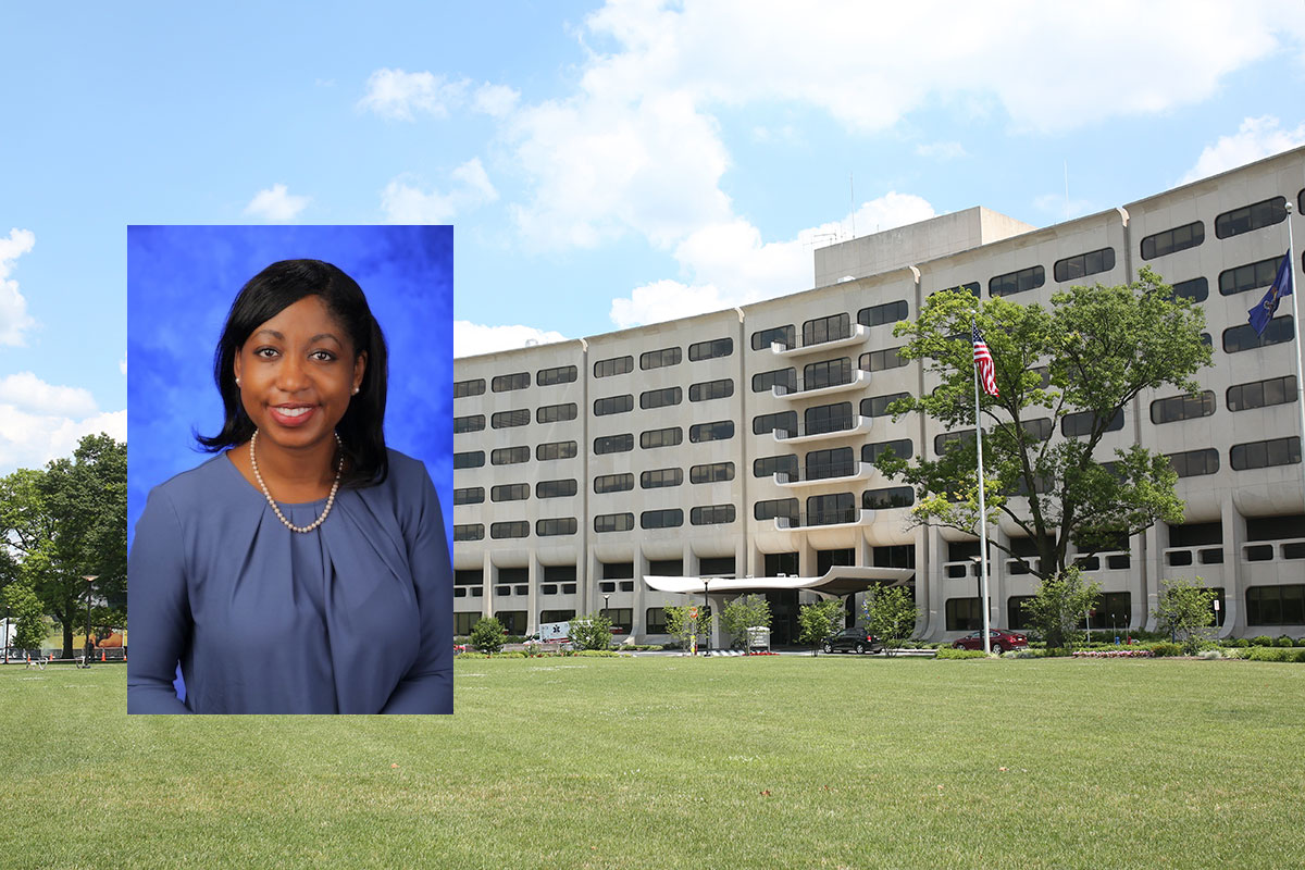 A head-and-shoulders professional photo of Yendelela Cuffee, PhD, MPH, is superimposed on a picture of Penn State College of Medicine's Crescent building in Hershey, PA.