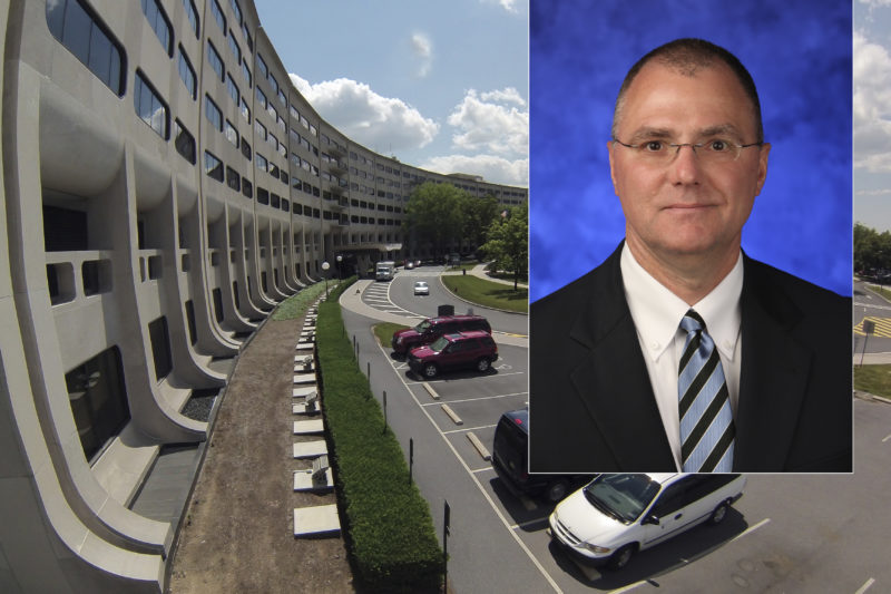 A photo of a man smiling superimposed over the Medical Center campus.