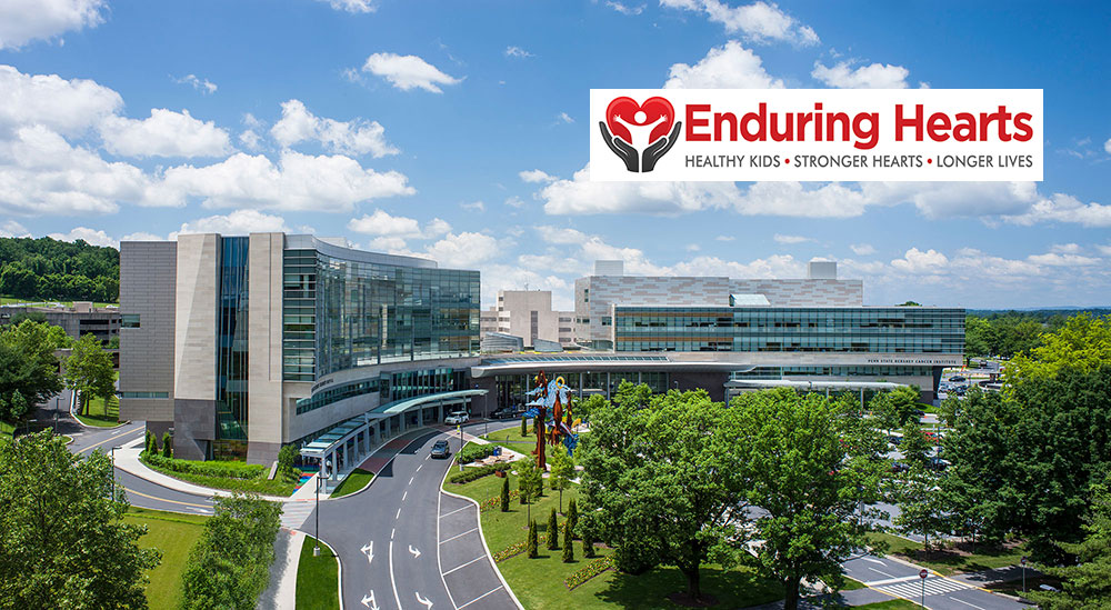 An aerial view of Penn State Health Milton S. Hershey Medical Center and Penn State Children's Hospital has the Enduring Hearts organization's logo superimposed at the top right.