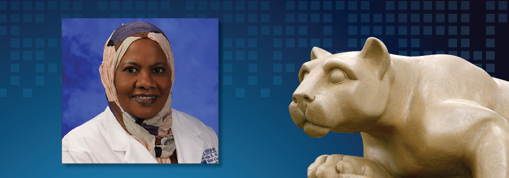 Dr. Alawia Suliman is pictured next to an image of the Penn State Nittany Lion statue.
