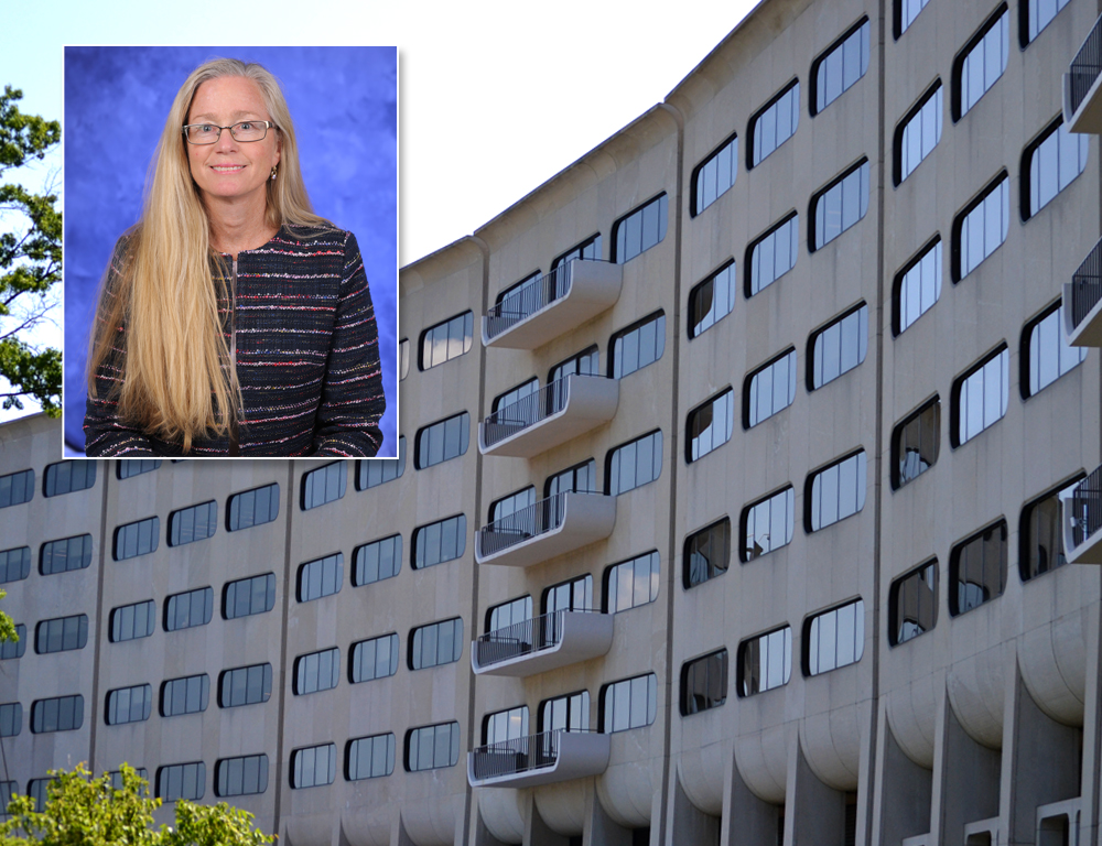 A photo of a woman smiling overlays a photo of the front of a multistory building with windows.