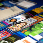 A table is full of brochures related to drug and alcohol addiction.