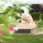 Penn State College of Medicine's Nittany lion statue is seen in a courtyard in the spring.