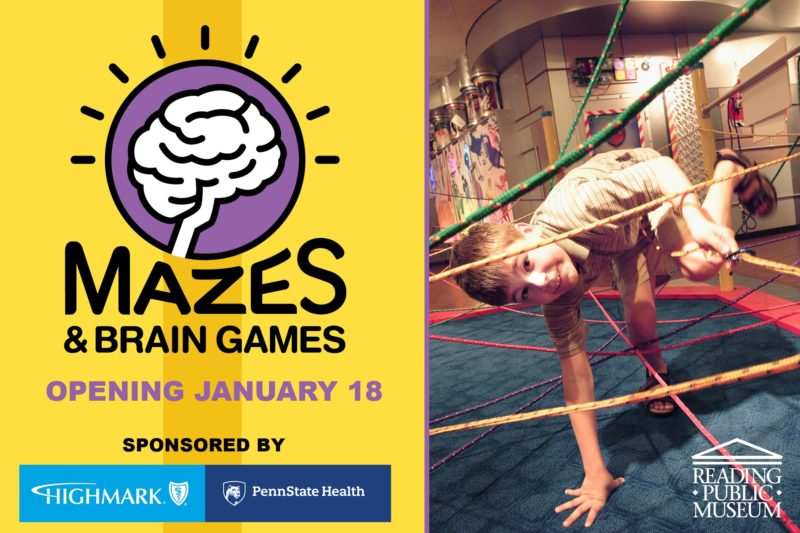 A child ducks through ropes in a room with displays on the wall. Next to him are the words Mazes & Brain Games Opening January 18. Sponsored by Highmark and Penn State Health.