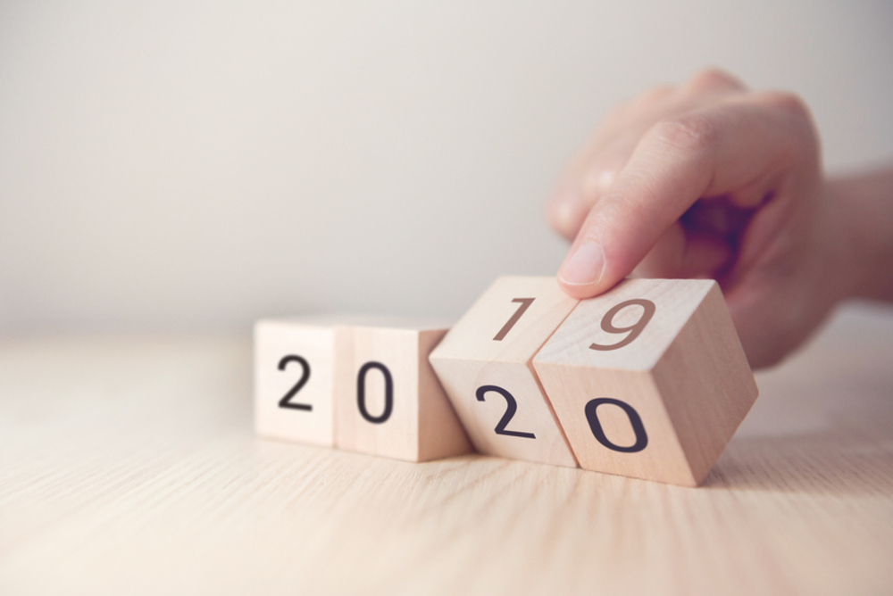 The image contains blocks with the numbers 2019 being turned to 2020.