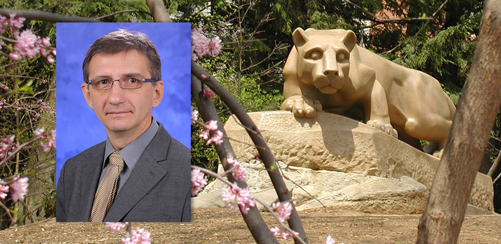A head-and-shoulders professional photo of Dr. Nikolay Dokholyan is superimposed on a photo of Penn State's Nittany Lion statue.