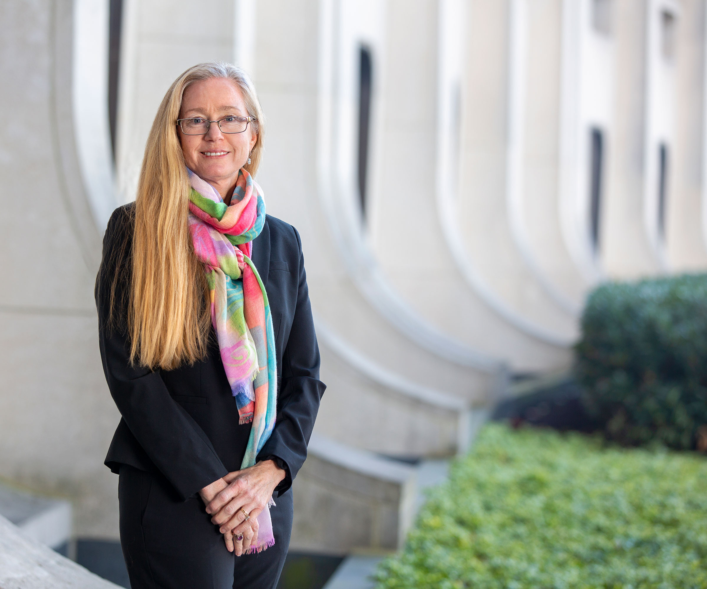 Dr. Patricia Sue Grigson stands outside Penn State College of Medicine in a professional portrait.