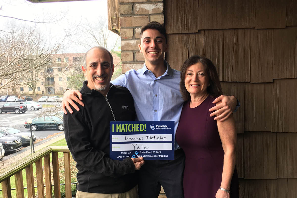 A fourth-year medical student celebrates being matched with his parents.