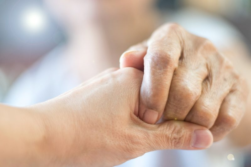 a close up of two hands holding one another