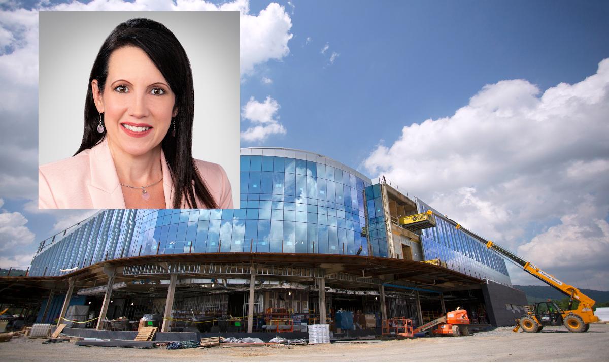 A headshot of a woman overlays a hospital
