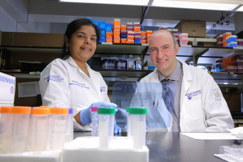 A woman and man work together on research in a laboratory.
