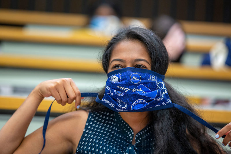 A first-year medical student wears a Penn-State themed mask during the incoming class of 2020 orientation on July 15.