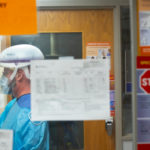 A person in full personal protective equipment in a hospital