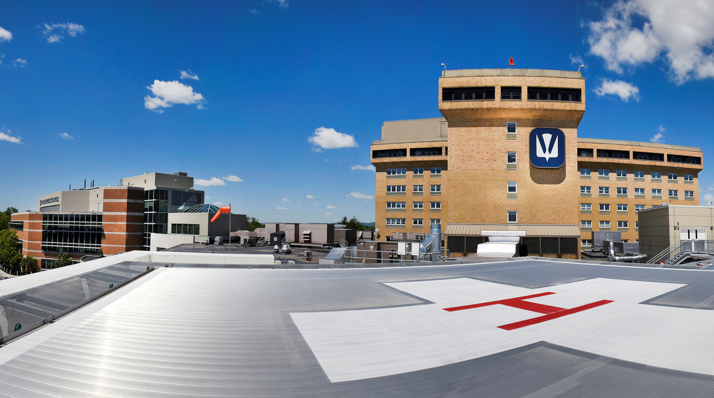From the vantage point of a rooftop helipad, the Holy Spirit Hospital bed towers rise to the right while the Ortenzio Heart Center is at left.