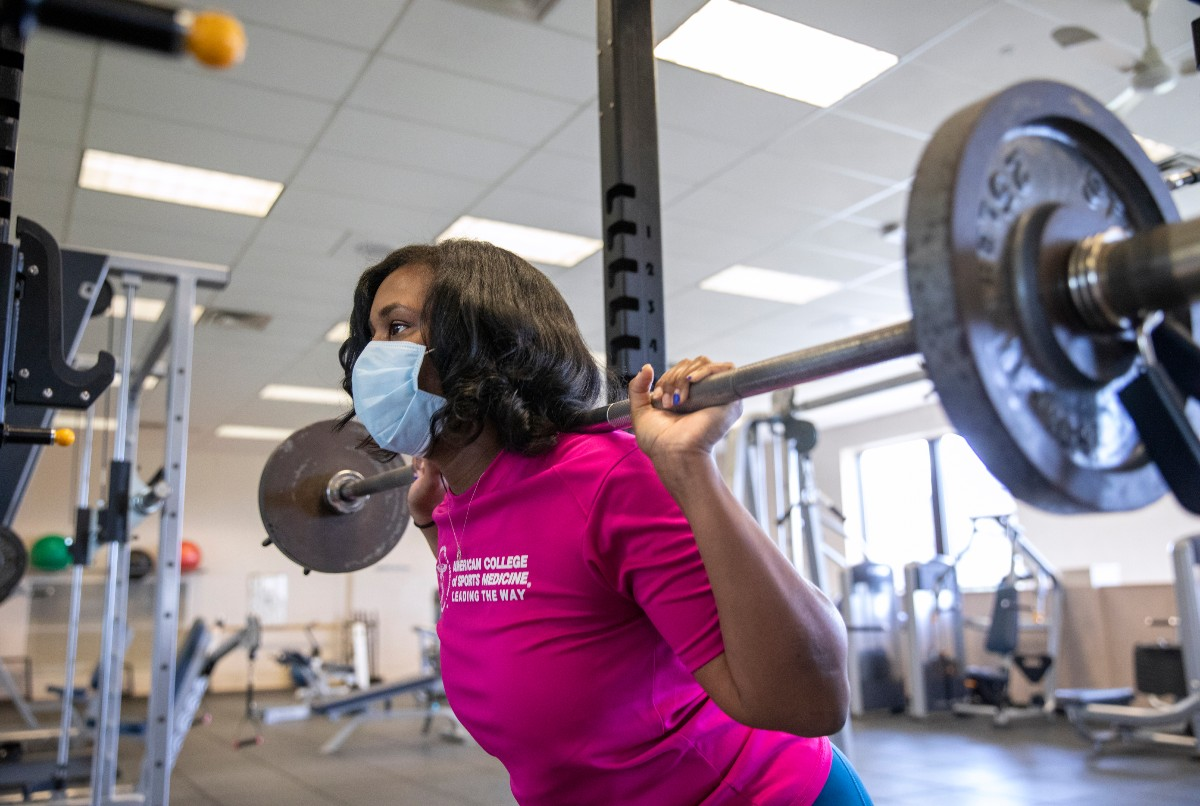 Natasha Renee Burse, a graduate student at Penn State College of Medicine, lifts weights at the University Fitness Center.