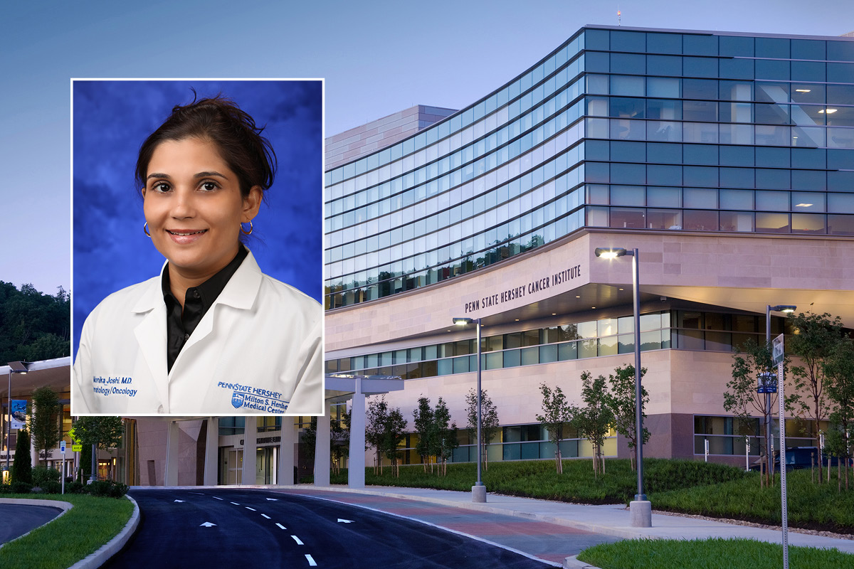 A head and shoulders professional portrait of Monika Joshi, against a background image of Penn State Cancer Institute