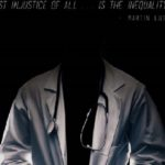 An image of a Black man in a white doctor's coat with a stethoscope around his neck.