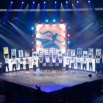 Students hold up placards that spell out the total amount raised during THON.