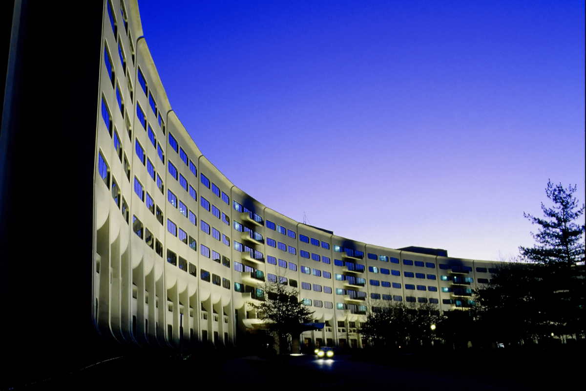 The crescent-shaped façade of Penn State College of Medicine is shown.