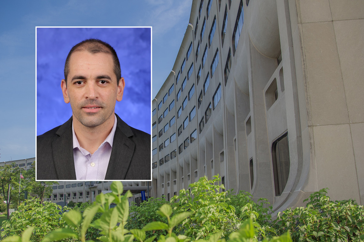A head and shoulders professional portrait of Mauricio Pontes against a background image of Penn State College of Medicine.