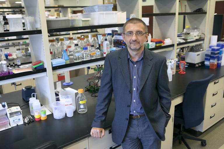 Nikolay Dokholyan stands at a laboratory bench.