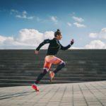 A woman runs outdoors.