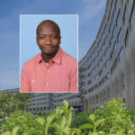 A head and shoulders professional portrait of Djibril Ba against a background image of Penn State College of Medicine.