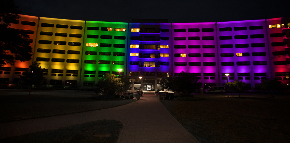The LED lights on the Hershey Medical Center are lit up in a rainbow of colors.