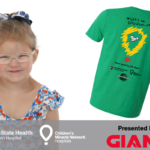 A young girl is pictured next to a T-shirt with the CMN logo on it. Logos for Penn State Health Children's Hospital, CMN and Giant appear across the bottom.
