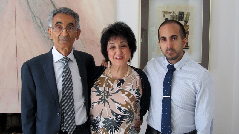 Dr. Vali Kermani, Mrs. Pari Kermani and Kia Kermani pose for a photo, standing side by side.