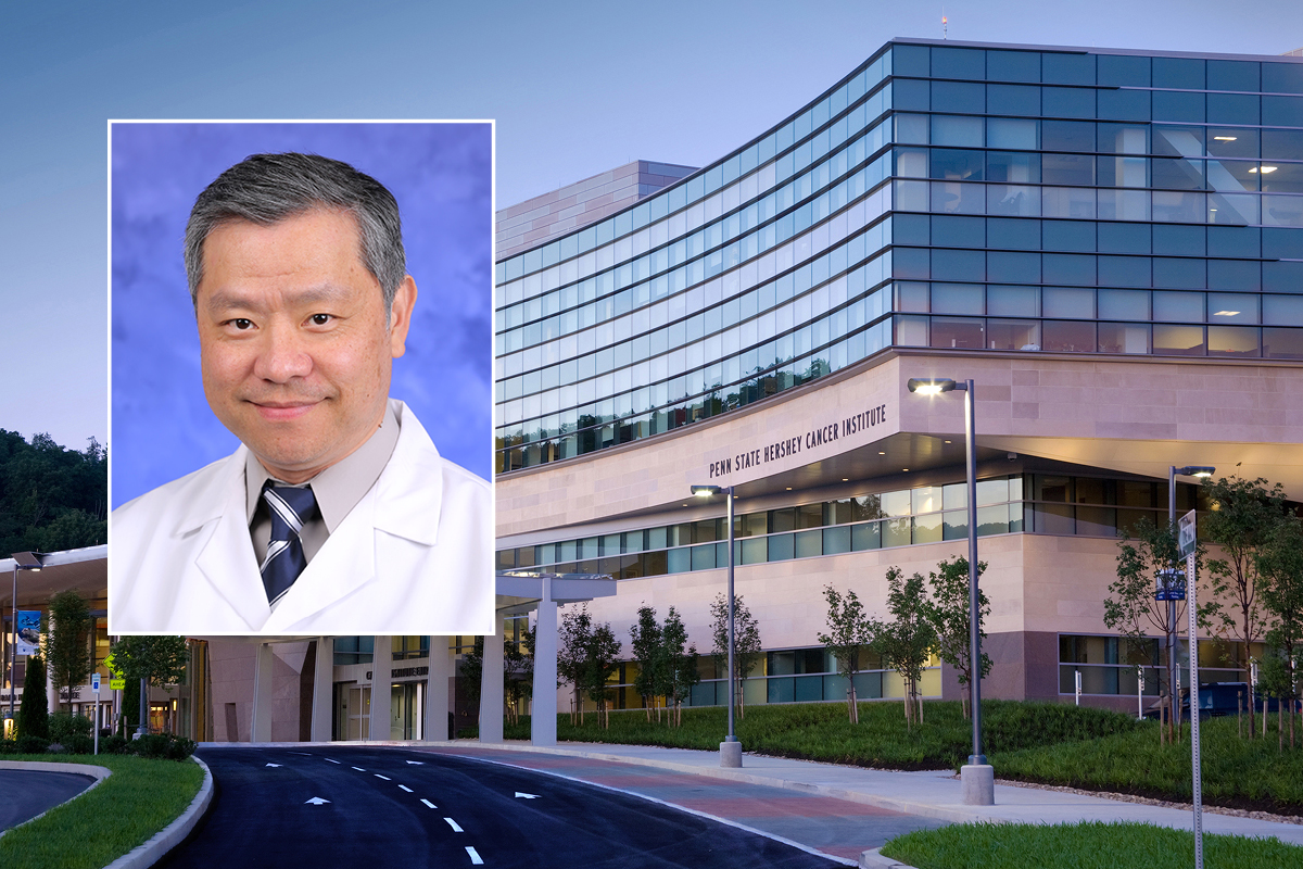A head and shoulders professional portrait of Dr. Patrick Ma against a background image of Penn State Cancer Institute