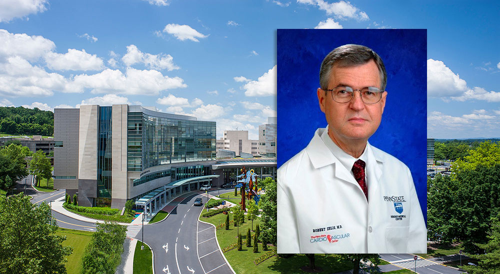 A head-and-shoulders professional photo of Dr. Robert Zelis is superimposed on an aerial view of the campus of Penn State Health Milton S. Hershey Medical Center in Hershey, Pa.